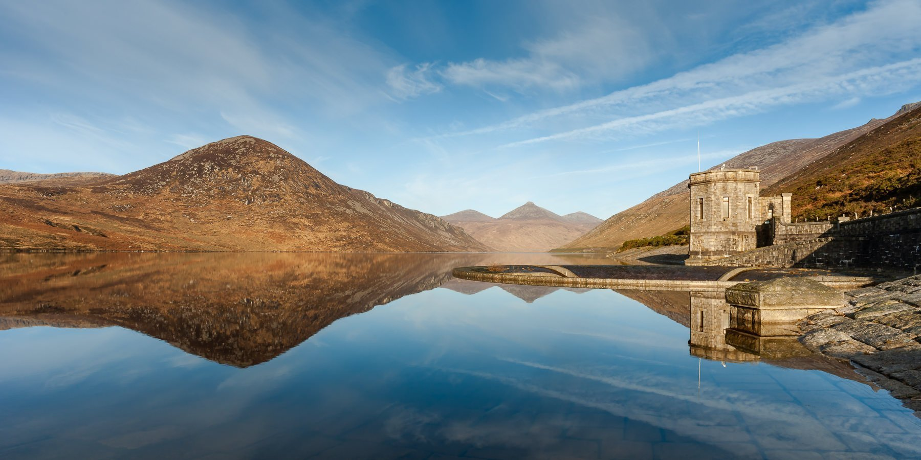 Silent Valley reservoir Co Down Northern Ireland, reflection of the Mourne Mountains on the still water