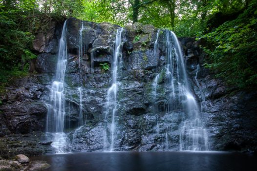 Image of a cascading waterfall in the Glens of Antrim, Northern Ireland