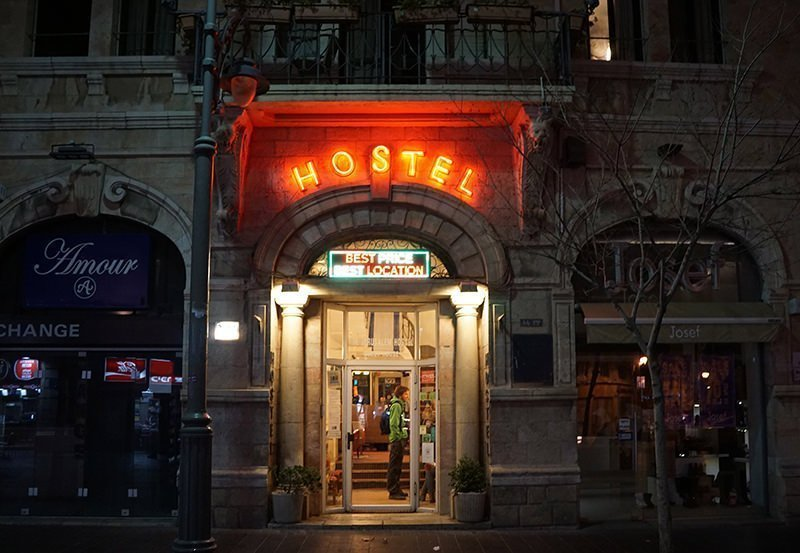 Hostel front with the text in red neon light