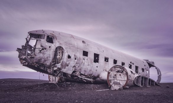 Abandoned plane wreck on black sandy beach in Iceland