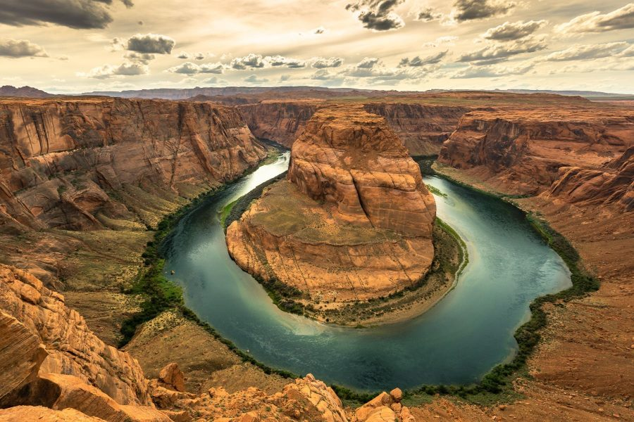 Colorado River flowing through a horseshoe shaped canyon.