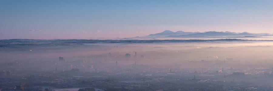 Looking over Belfast City with a blanket of mist as far as the Mourne Mountains