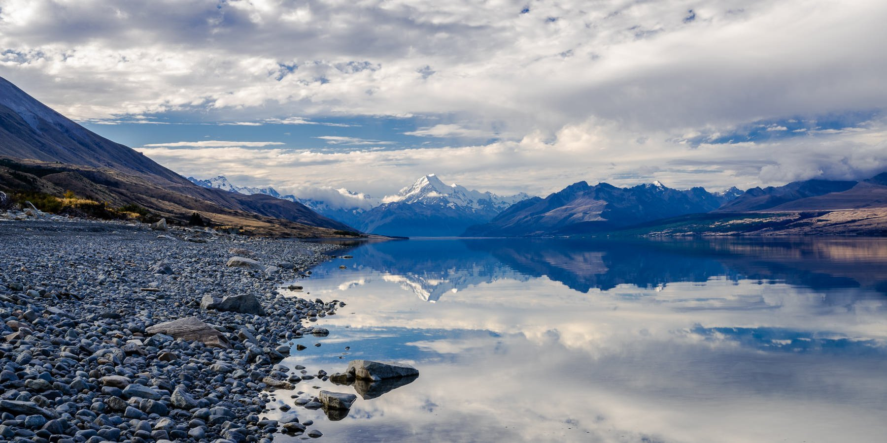 Mount Cook and its reflection in Lake Pukaki on a calm still evening in New Zealand